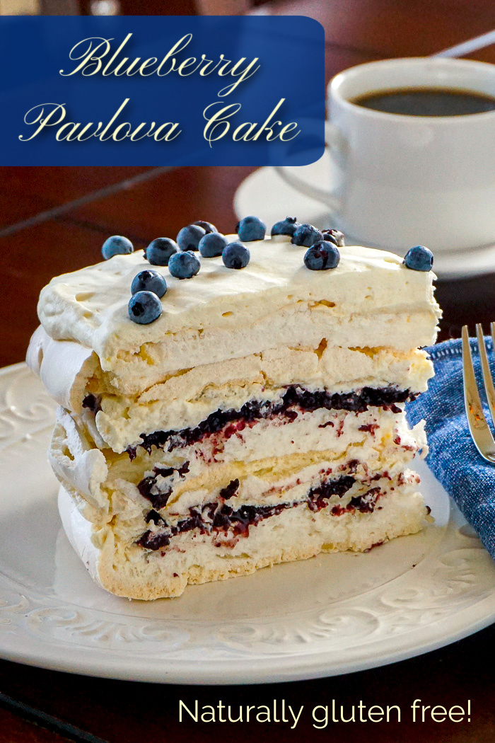 Blueberry Pavlova Cake photo of one slice with title text added for Pinterest