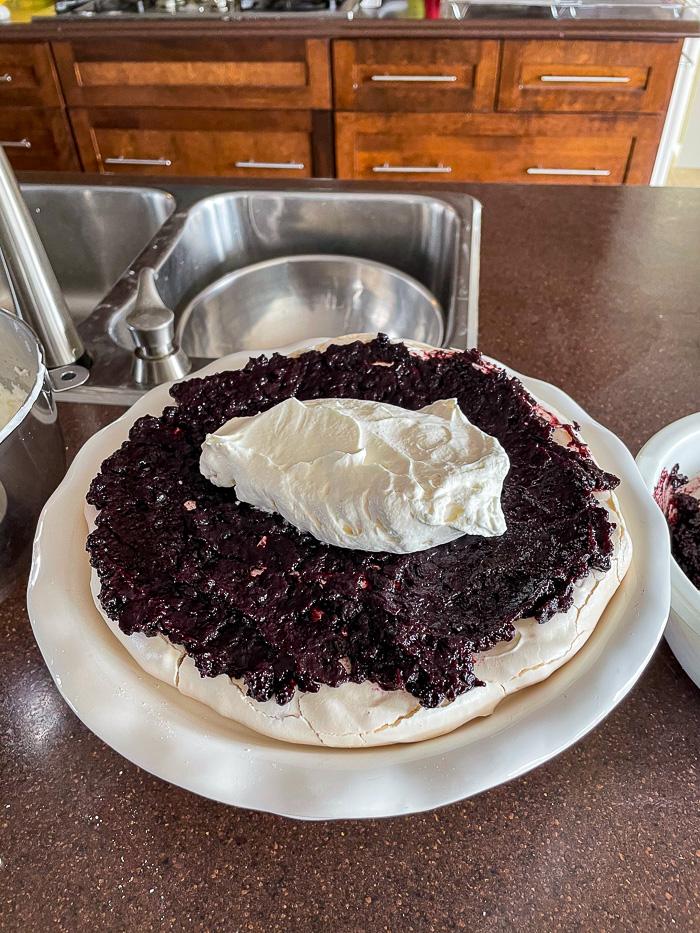 Photo of blueberry pavlova cake being constructed