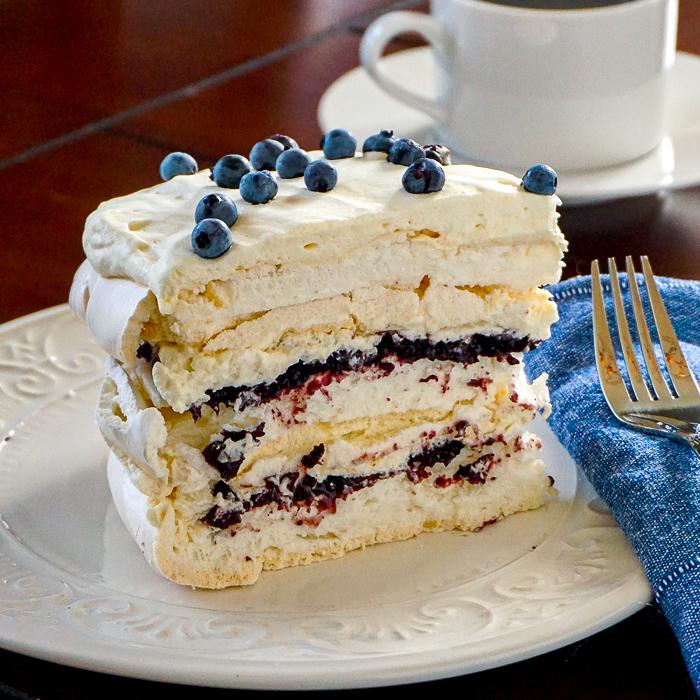 Photo of one slice of blueberry pavlova cake